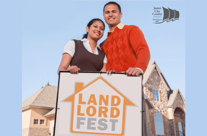 couple behind Landlord Fest sign