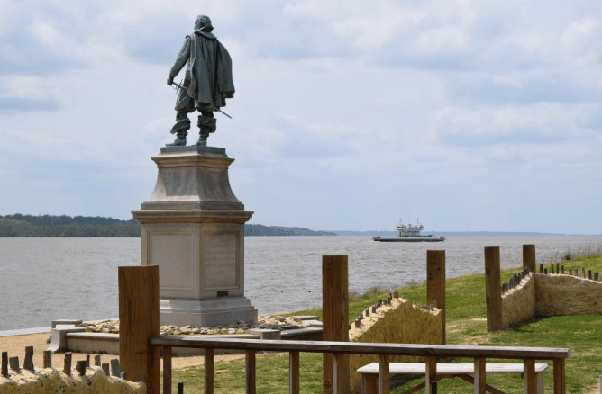 Historic Jamestowne Captain John Smith statue facing towards river