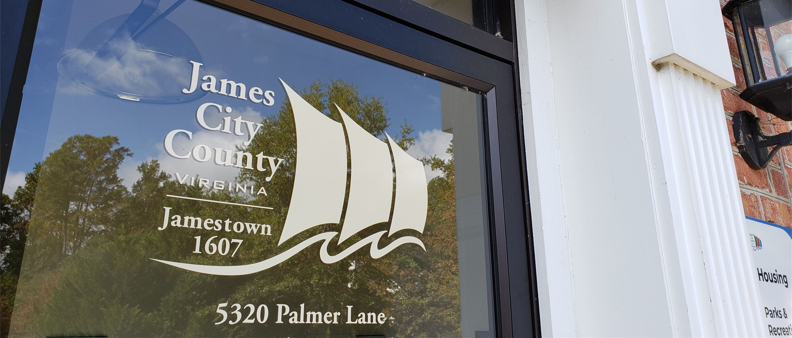 Glass Door with James City County logo and 5320 Palmer Lane