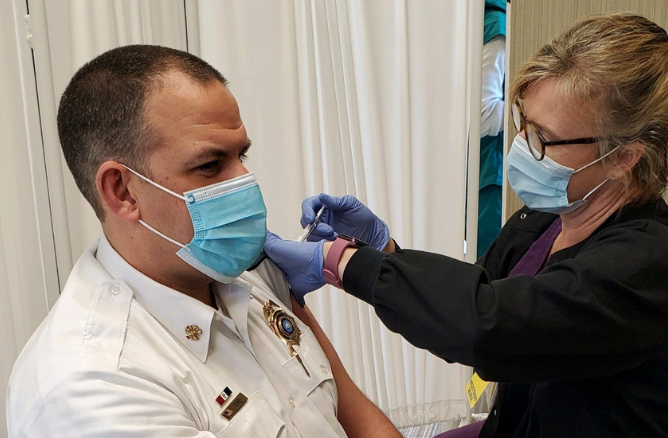 Fire Chief Ryan Ashe gets COVID-19 vaccine