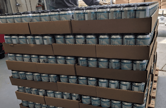 Stack of Billsburg Brewery canned beer