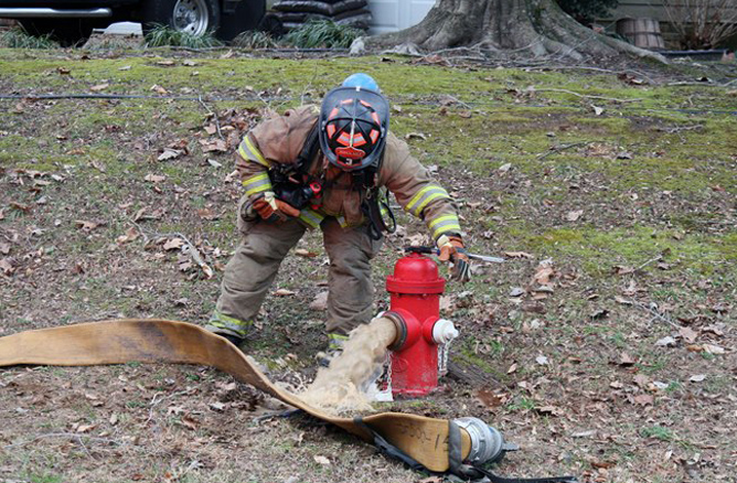 Firefighter with hydrant